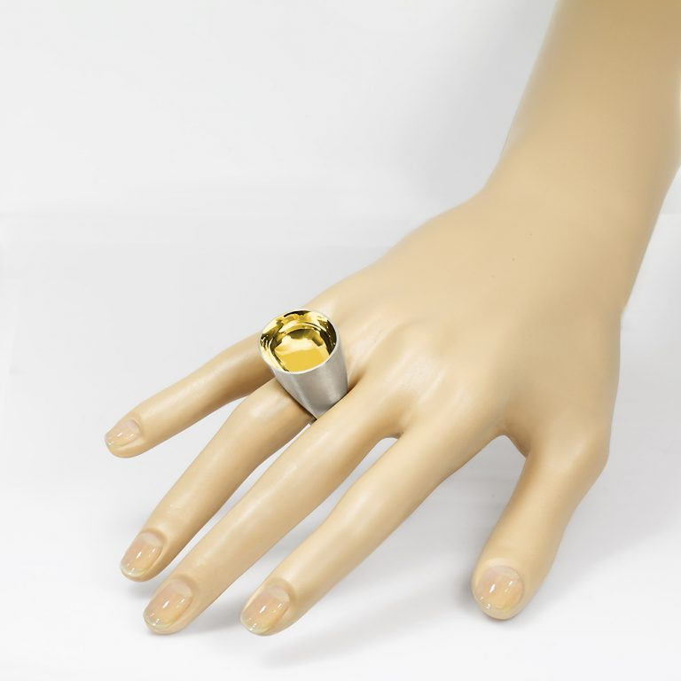 The Saarinen ring from The Modernists collection is handmade by Julie Bégin using sterling silver with 14k gold.