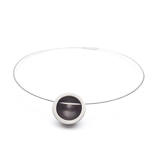 The Niemeyer necklace from The Modernists collection is handmade by Julie Bégin using pure sterling silver.