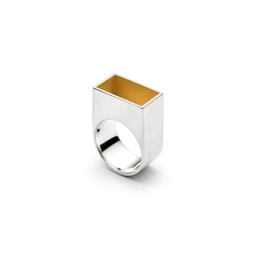 The Gropius ring from The Modernists collection is handmade by Julie Bégin using pure sterling silver with 24 k yellow gold.