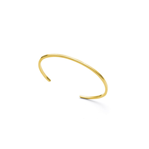 The Mies bracelet from The Modernists collection is handmade by Julie Bégin using pure 14k yellow gold.