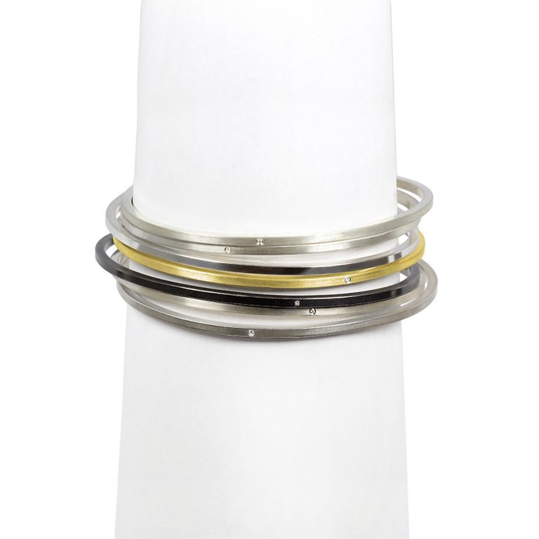 The stackable bangle bracelets from the Celebration collection, handcrafted by Julie Bégin using sterling silver or 14k gold and genuine diamonds.