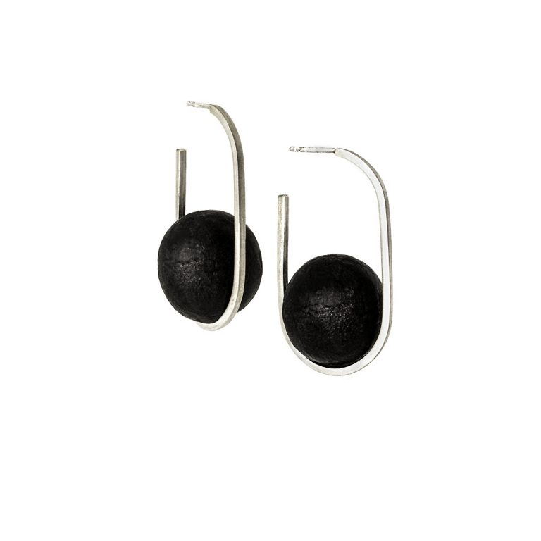 Orbital earrings from the Quantum collection, handcrafted by Julie Bégin using pure sterling silver and hand charred wood.