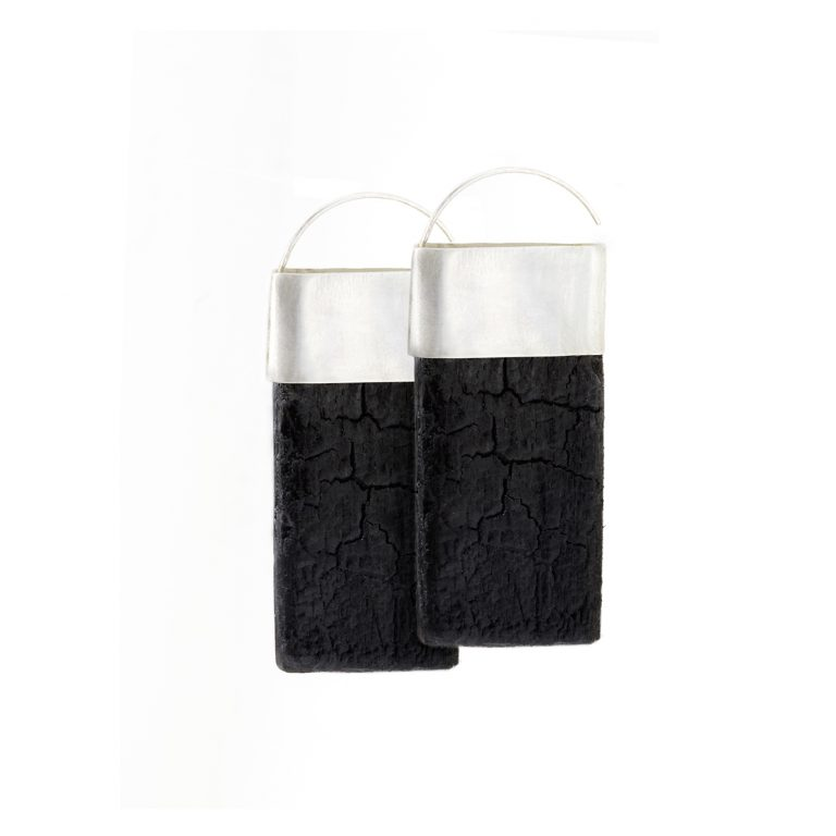 Plane earrings from the Quantum collection, handcrafted by Julie Bégin using pure sterling silver and hand charred wood.